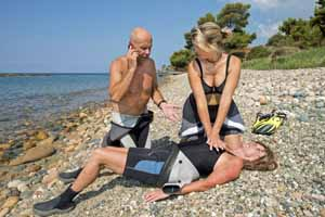 couple giving cpr to woman on beach